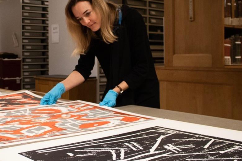 Dr Lena Fritsch looking at A. R Penck's artworks in detail