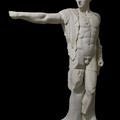 White cast statue of the god Apollo, with his arm outstretched