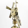 Gold model windmill atop an inverted golden cup