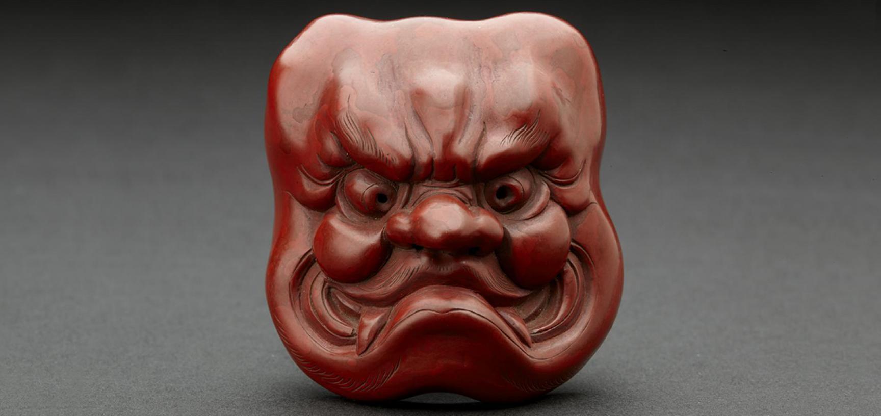 Netsuke Red lacquer mask of Ō-Beshimi by Matsuki Hōkei