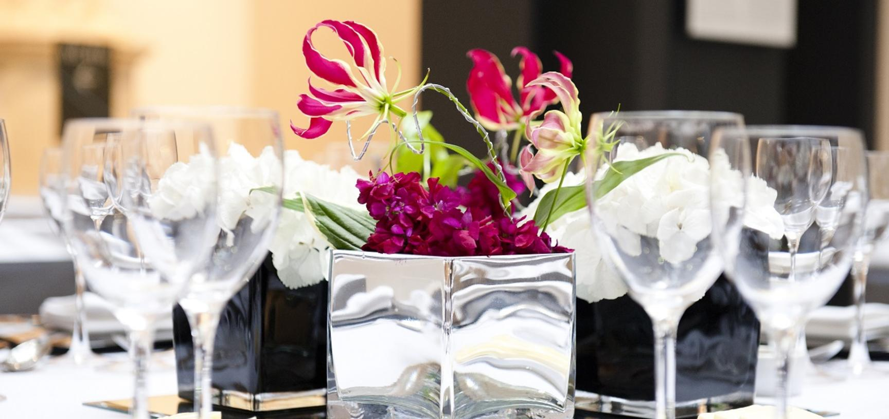 Table centrepieces for corporate dinner in Atrium