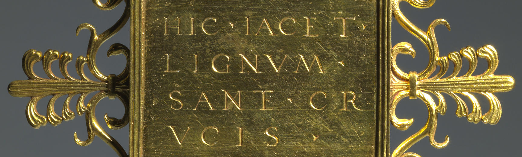 The back of a gold renaissance reliquary inscribed with latin