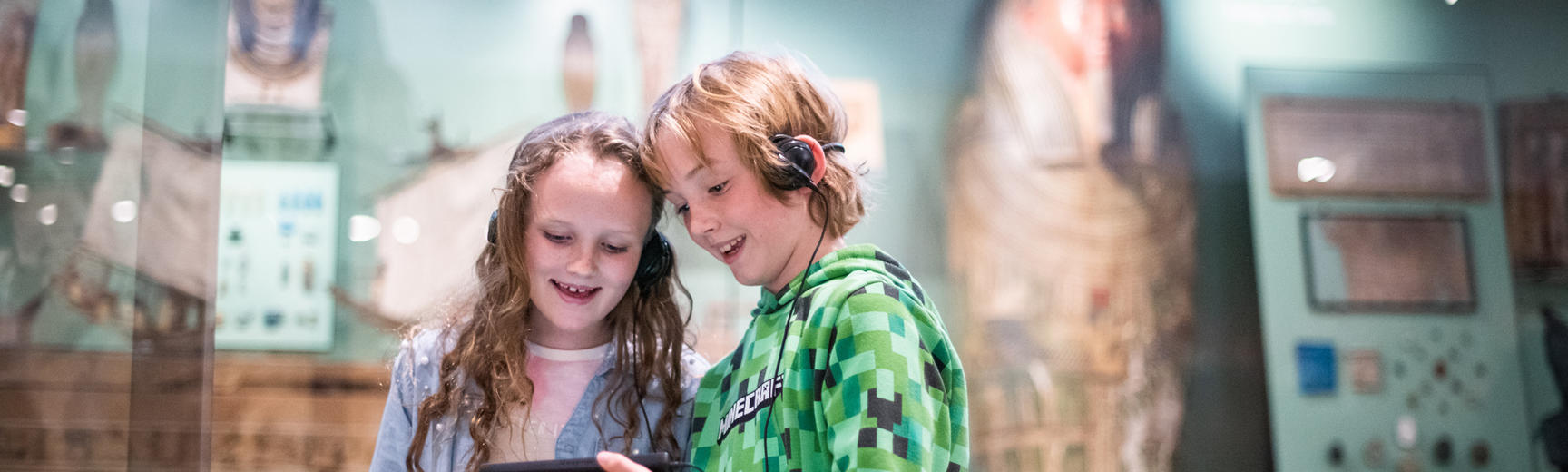 Two children in the Egypt gallery holding multimedia guides