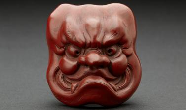 Netsuke Red lacquer mask of Ō-Beshimi by Matsuki Hōkei