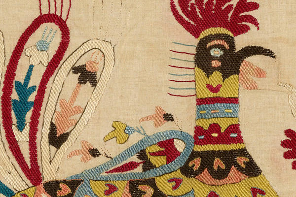 A colourful stylised embroidered cockerel