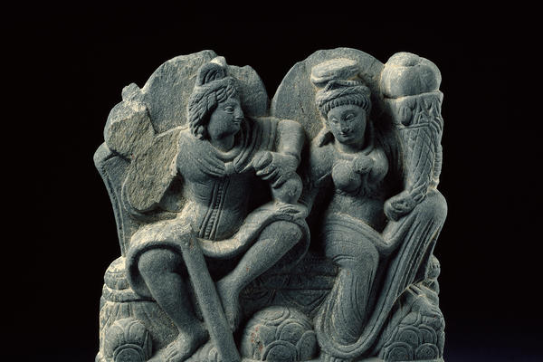 Hariti seated with Panchika, holding 'horn of plenty'