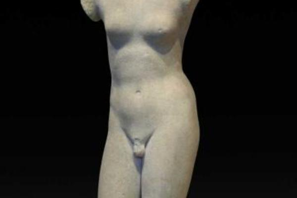 A white marble statue missing head and arms
