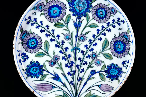 Colourful patterned dish decorated with stylised flowers