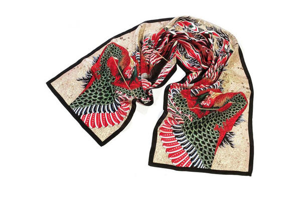 Elegant scarf with decorative intricate red, green, black and white bird design, with birds head on either side of scarf tail