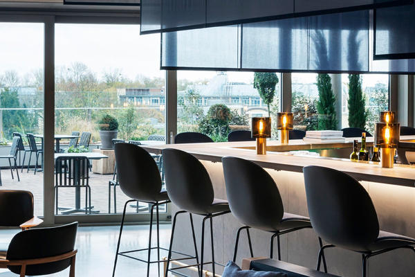 Photograph of the bar and bar stools at the empty Sticks'n'Sushi restaurant in Oxford