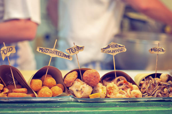 A close-up photograph of various items of street food for sale in Naples, Italy