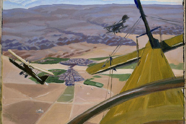 Four First World War planes flying over a rural landscape with mountains in distance, view from cockpit