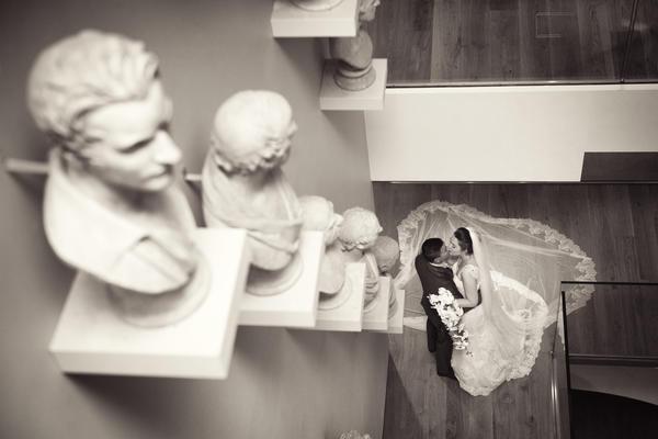 Wedding couple on staircase descending into the atrium