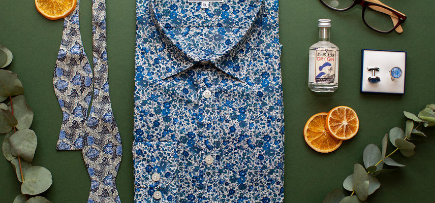 A selection of gifts including shirt, bowtie, glasses and cufflinks