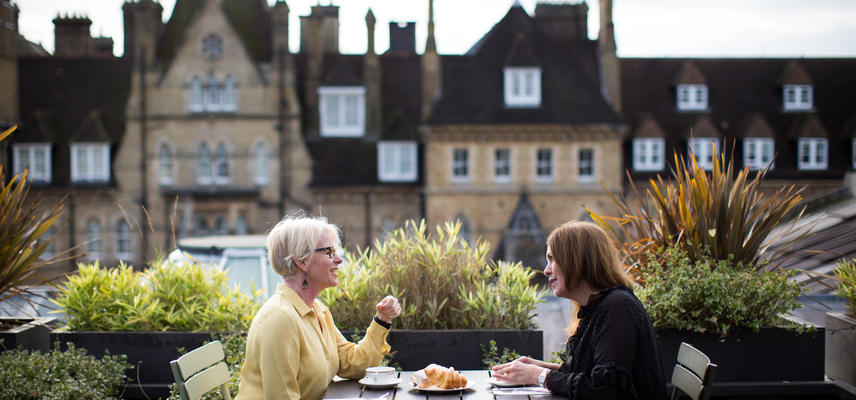 Two women at a table on the terrace of the rooftop restaurant