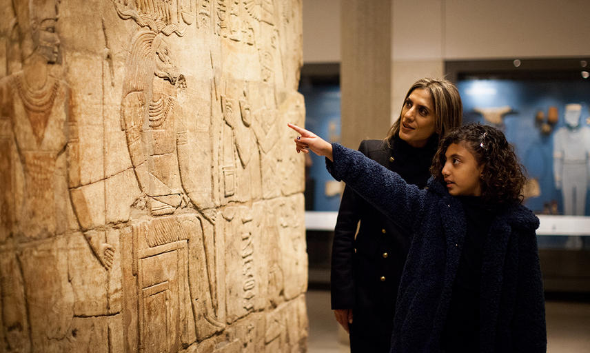 Mother and Daughter looking at Hyroglyphics