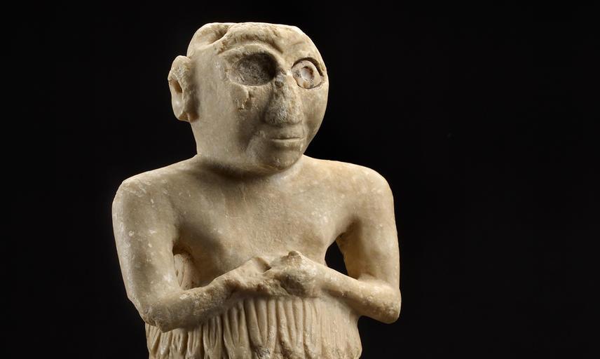 A limestone statue of a male figure