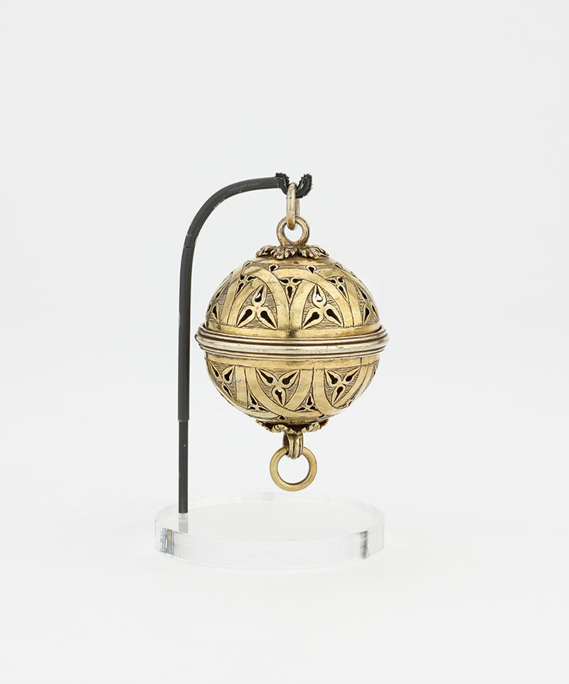 A gold spherical pomander to hold various scents