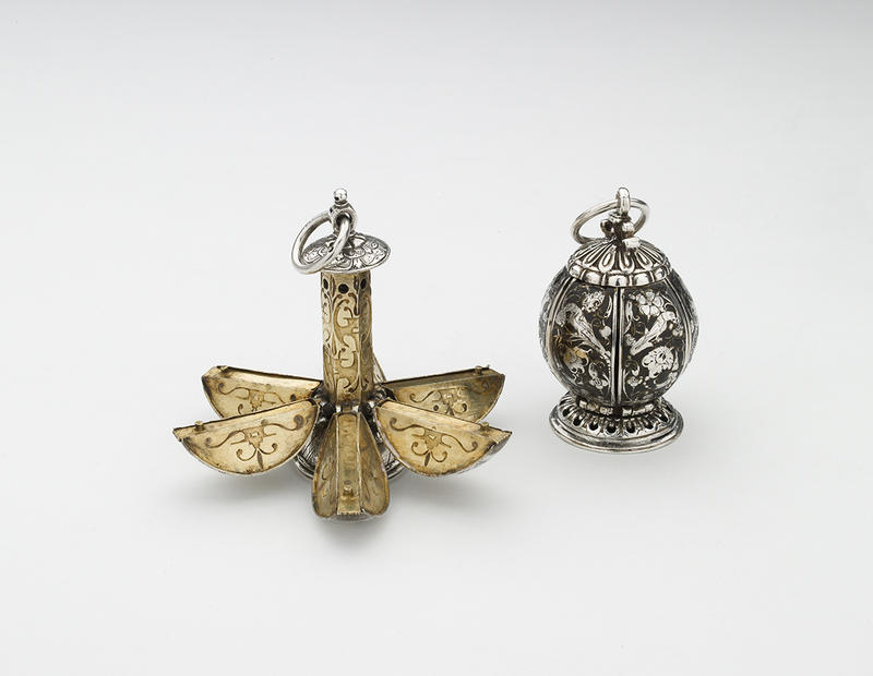 Two silver and god spherical pomanders, one is open into segments