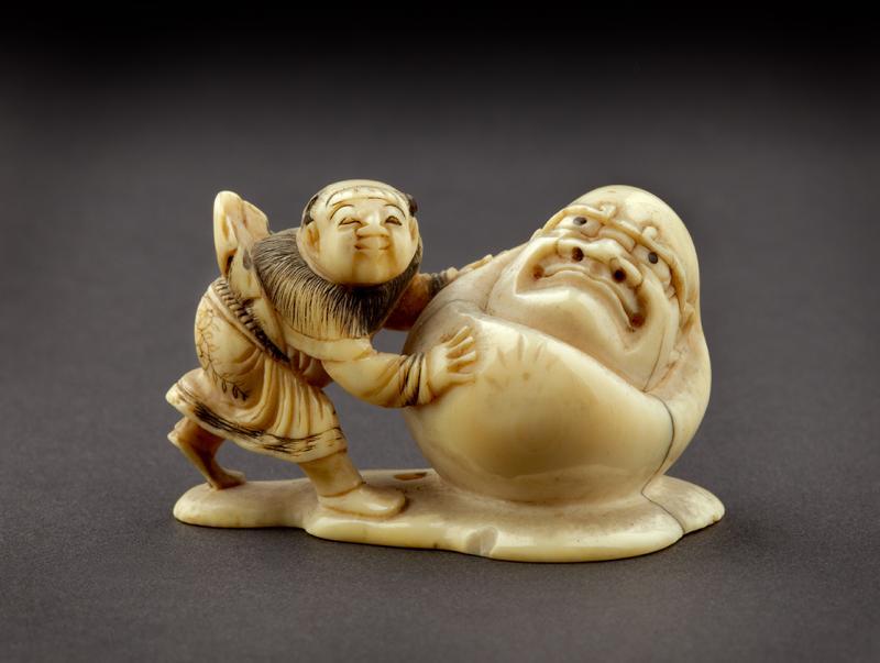 EA1956.1738 Netsuke in the form of a boy rolling a yuki daruma, or snowman