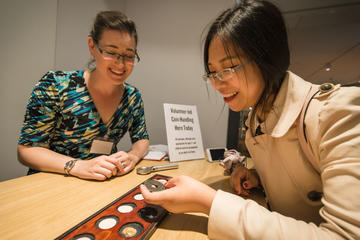 Hands on coins