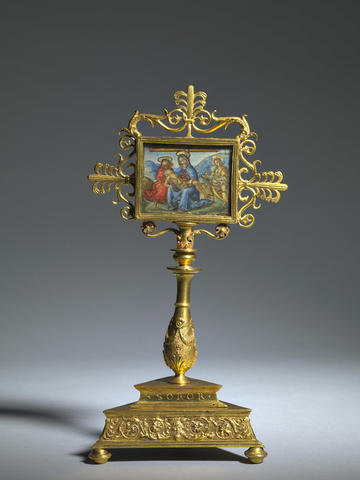 A gold renaissance reliquary featuring a religious painting